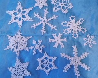 "12 crochet Lacy snowflakes beautiful design perfect for Christmas/winter decoration 2"" to 4"" wide"