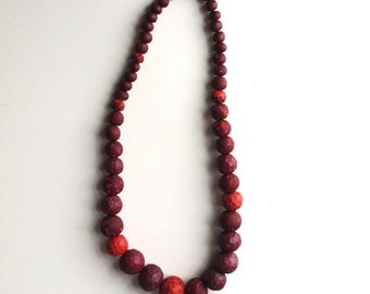 Red,  hand carved necklace