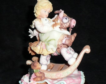 Musical Figurine - Girl on Rocking Horse
