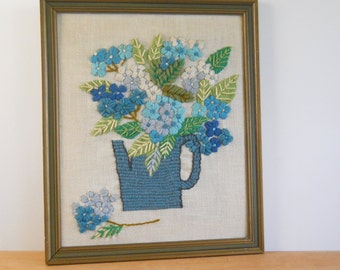 Vintage Crewel Work Blues and Greens • Floral Arrangment in Watering Can • Framed 1970's Fiber Art