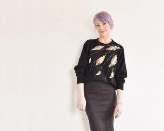 sequin feather knit sweater . black gold razzle dazzle wear .medium.large .sale