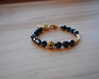 Charcoal Grey Glass Beads with Gold Skull Bracelet