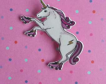 Roller skating unicorn brooch