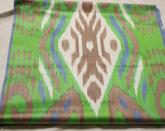 Uzbek colorful silk ikat fabric. Traditional woven fabric Adras