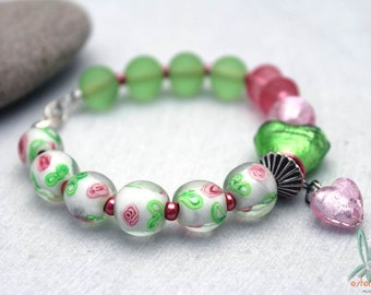 Spring flowers - unique, budget friendly, handmade bracelet in pink and green with lampwork and silver foil glass