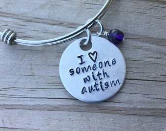 "Autism Quote Bracelet- ""I (heart) someone with autism"" with an accent bead of your choice"
