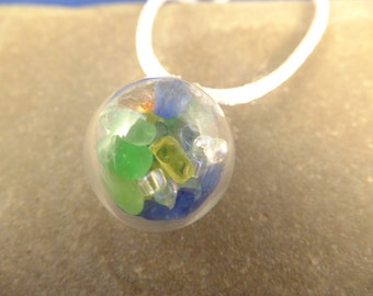 Delicate globe pendants with sea glass and clear seed beads on adjustable satin cord