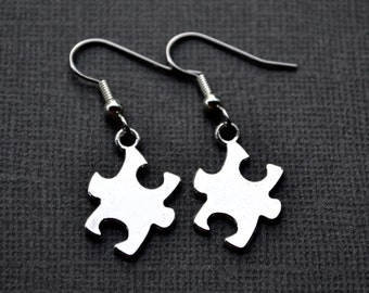 Silver Jigsaw Puzzle Pieces . Earrings