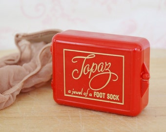 Vintage Foot Sock Holder in Red Plastic with Socks by Topaz