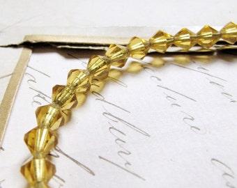 vintage bicorn glass beads - 1950s citrine amber glass - 5mm - 27 beads