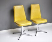 Pair of Bright Yellow Vinyl and Chrome Swivel Dining Chairs