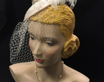 Adorable feather, pale pink silk and lace fascinator hat