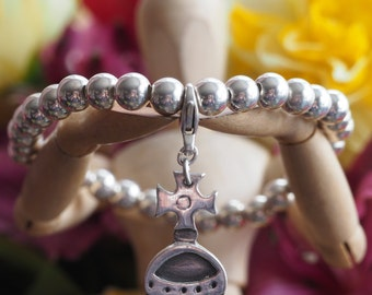 A sweet little royal Orb charm handmade from fine silver on a sterling silver bead bracelet ....