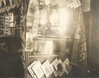 "Vintage Snapshot ""The News Stand"" Souvenir Tourist Magazines Postcards Newspapers Native American Blanket - Odd Lighting - Found Vernacular"