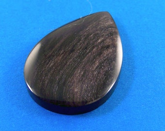 Gold sheen obsidian cabochon