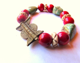 Gypsy/ Boho/ Southwest Stretch Bracelet - Baule brass trade Sun Moon Design bead-Ghana, Yak Bone, Genuine Green Turquoise Nuggets, Red Coral