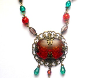 Bronze colour steampunk, victorian, goth necklace with amber red color pendantr, red, brown, green glass beads.