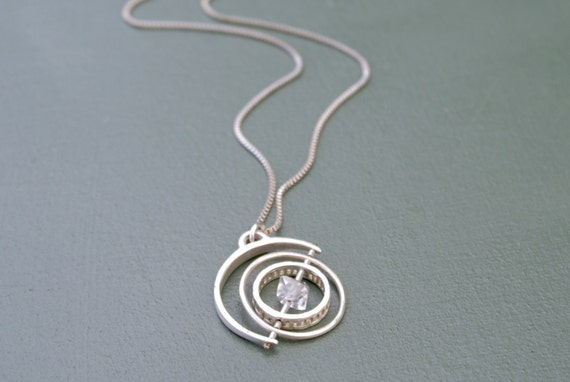 the Silver Herkimer Gyroscope necklace