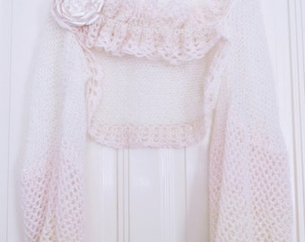 Knitted wedding bolero with crochet details. Nice complement to her wedding dresses.