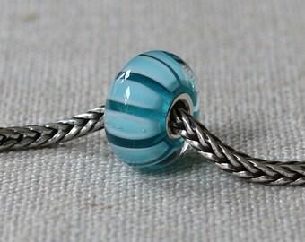 Marine turquoise stripe lampwork bead