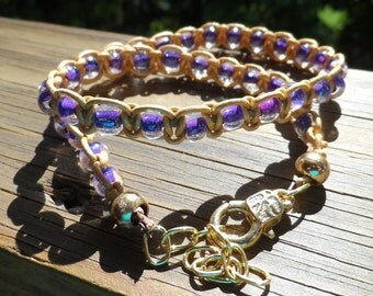Double wrap bracelet in metallic gold leather and purple glass beads with lobster clasp