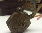 Vintage Brass Pentagon Lighter with Raised Center relief of Eagle Emblem