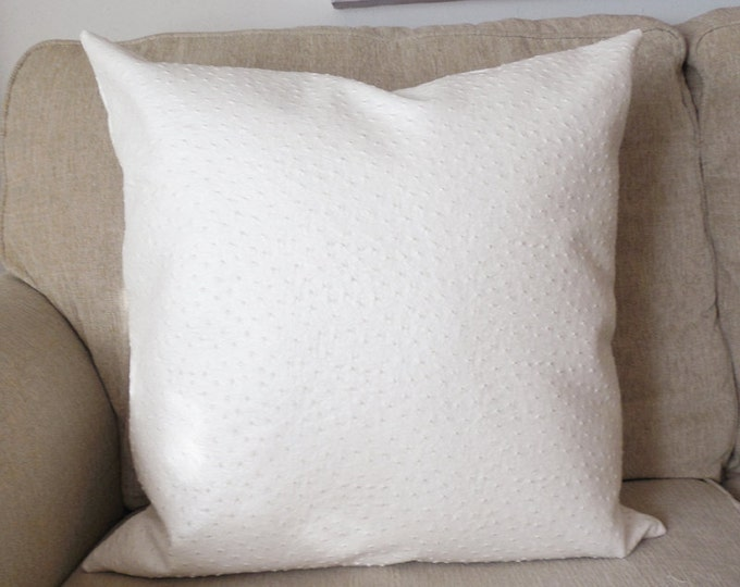 off-white faux leather pillow with metallic sheen