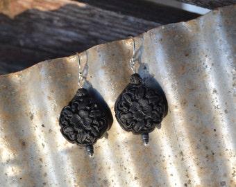 Black floral cinnabar dangle earrings.