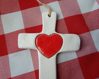 Ornament. Simple Ceramic Cross with Heart.