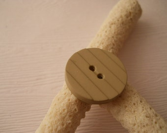 BUTTONS:  Light khaki buttons, just under 7/8 inch size, two hole, set of 8 buttons.