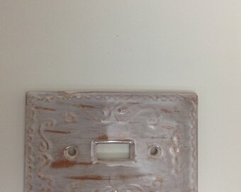 Distressed cottage look switch plate