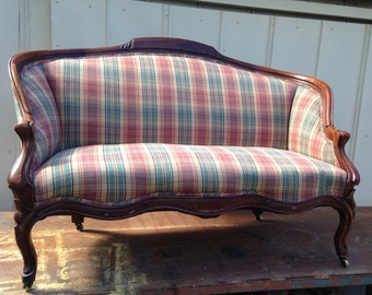 Antique Settee loveseat Solid Mahogany wood Upholstery excellent condition brass casters Plaid fabric