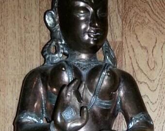 Metal lady dancer statue