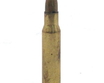 Bullet lapel pin made with brass .308 bullet casing and fake bullet tip.