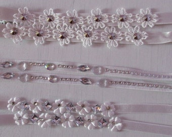 Various white wedding bra straps. flowers, diamante jewels studs. Will jazz up outfit. Will not give support. UK SELLER.