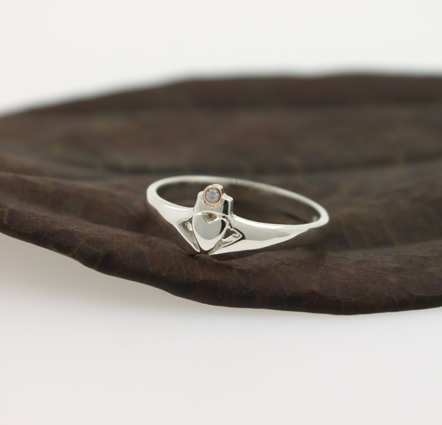 claddagh ring with real diamond set in a rose gold bezel. Black Bedroom Furniture Sets. Home Design Ideas