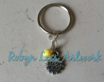 Tiny Silver Beach Bum Sun Keyring with Bright Yellow Bead, Surfer, Holiday, Ocean
