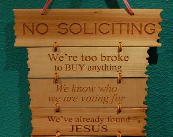 NO SILICITING sign.