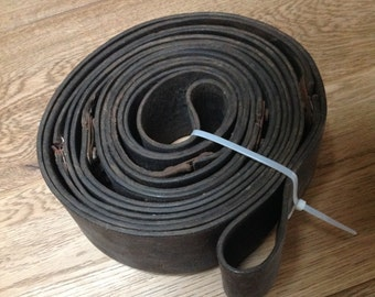 """6 mtr- 19.68 ft. x 3 1/4"""" connected soft leather ring, 12 belts, cuffs, leather tooling and jewelry."""