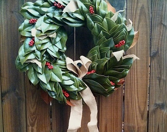 Fresh magnolia wreath with red berries