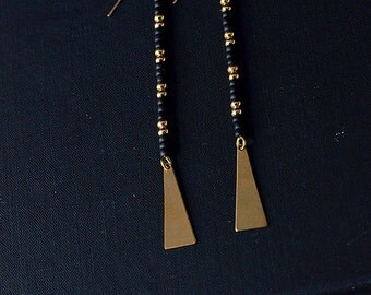 longline. pair of seed bead dangle earrings on 14kt gold filled ear wires with triangles. bohemian. festival wear. brass. 14kt gold. black.