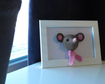 Framed Amigurumi Mouse, cute crochet brown mouse with a pink scarf mounted on a picture frame.