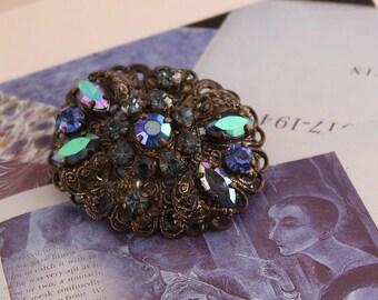 Vintage Germany Ornate Filigree Brooch, Blue Rhinestones and  Aurroa Borealis