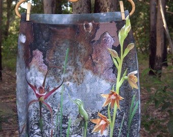 Pencil Skirt, Rusty Spider & Native Orchids against Rusty Tin,
