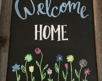 Welcome Home Chalkboard Sign with spring flowers