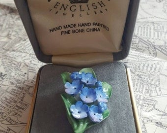 Hand Painted Bone China Floral Blue Flower Brooch. Made in England. Boxed.