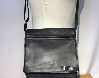 Small waterproof bag with a leather flap for men