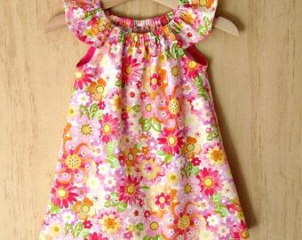 Girls flutter sleeve dress. Toddler girls dress. Girls peasant sleeve dress. Baby girls dress. Girls bright floral dress. Baby girls dress.