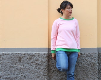 Watermelon no logo sweatshirt. Pastel pink light weight sweatshirt with bright green ribbing. Classice raglan sleeve. Sizes from S to XL.