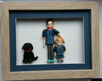 Family portrait in a shadow box frame; fimo figurines, Mcfaerie